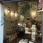 Shop with colorful paintings and plants